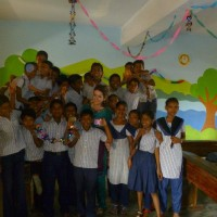 Lauren in newly painted classrooms with students