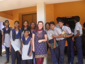 Lucy with students at her school
