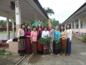 Katie with fellow volunteers Chloe & Ellie, with school teachers in traditional dress
