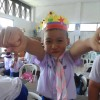 Student with the crown he made in Katie's class