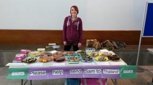 Sam holding her cake sale that raised £50.